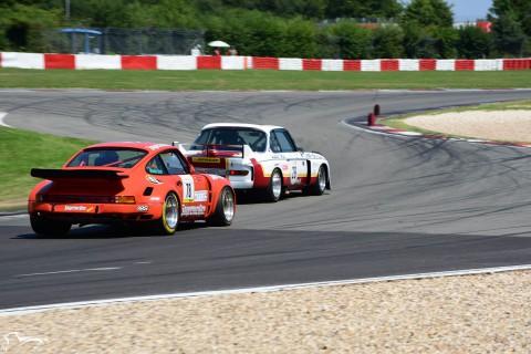 AVD BMW 3.5 CSL E9R n°29 of Dieter Tögel VS Porsches 911 RSR n°78 of Ottokar Krust